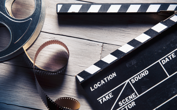 http://www.shutterstock.com/pic-169841813/stock-photo-movie-clapper-and-film-reel-on-a-wooden-background.html?src=09nt-qPXIeVwoVai80KJFg-1-15