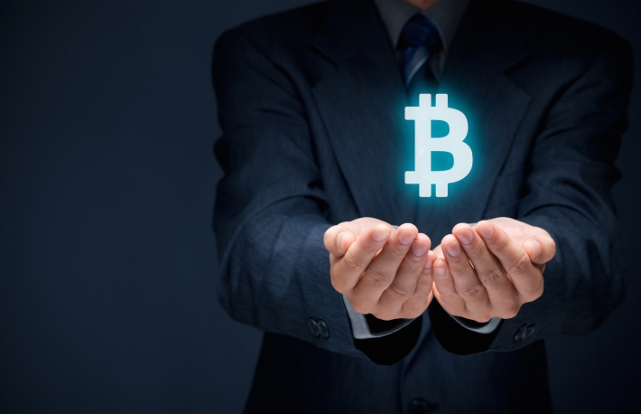 http://www.shutterstock.com/pic-260188916/stock-photo-bitcoin-in-business-and-commerce-businessman-offer-bitcoin.html?src=z617T_x6TcM3j8SzOU0Xvg-1-29