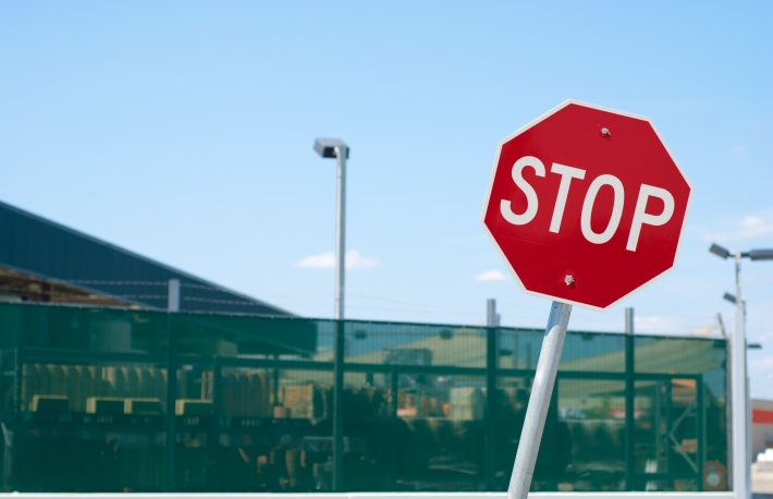 http://www.shutterstock.com/pic-219701602/stock-photo-red-stop-sign-in-front-of-a-warehouse-fence.html?src=Ri_rt6JOhfrjoIJnrOLl0g-1-42