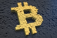 Gold and black bitcoin symbol