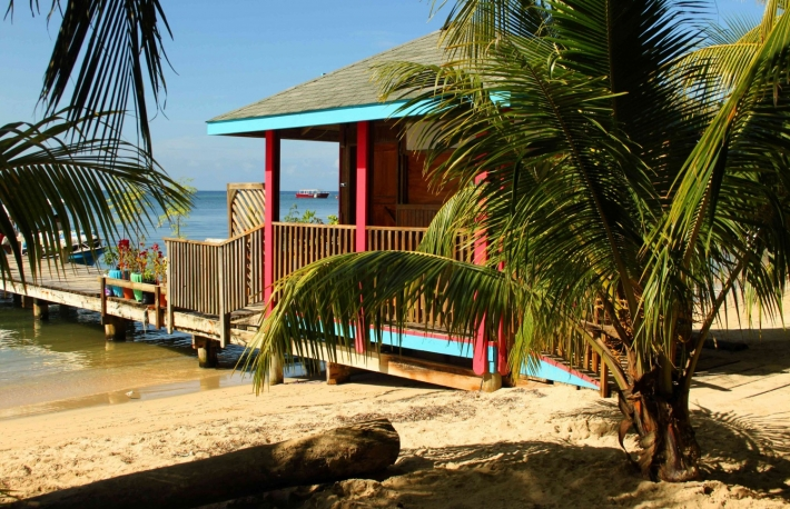 http://www.shutterstock.com/pic-171313526/stock-photo-colorful-beach-hut-roatan-honduras.html