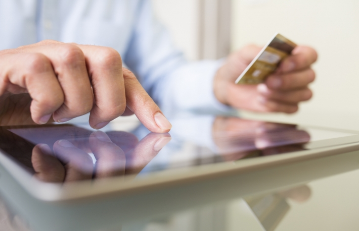 http://www.shutterstock.com/pic-163502138/stock-photo-man-holding-tablet-pc-and-credit-card-indoor-shopping-online.html?src=Bwcxlndsp0oaBD0AKbtRyA-1-0