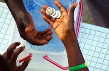 http://www.shutterstock.com/pic-57193945/stock-photo-money-changing-hands-on-the-street-of-ghana.html