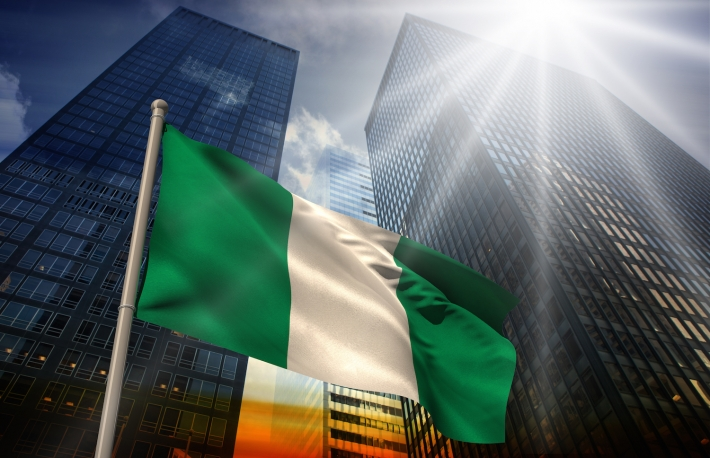 http://www.shutterstock.com/pic-189093872/stock-photo-nigeria-national-flag-against-low-angle-view-of-skyscrapers-at-sunset.html?src=WQuFmJTooyT9GhI6mT41Mg-1-2