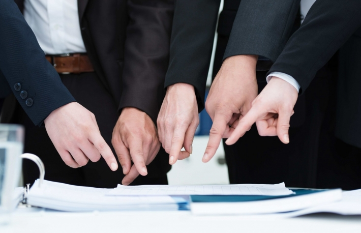 http://www.shutterstock.com/pic-153244316/stock-photo-group-of-businesspeople-pointing-to-a-document-on-a-desk-close-up-cropped-view-of-their-hands.html?src=2VGwL6Ap9zODtfSRuI6q9A-1-0