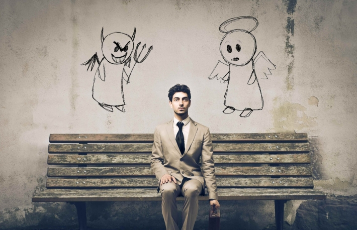 http://www.shutterstock.com/pic-124098307/stock-photo-businessman-sitting-on-a-bench-with-an-angel-and-a-devil-on-his-sides.html