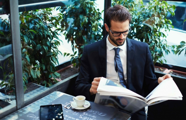 http://www.shutterstock.com/pic-252855406/stock-photo-portrait-of-a-young-handsome-businessman-reading-a-newspaper-at-his-breakfast-in-coffee-shop.html?src=kb4lZIG66uh14NHoQPVK2Q-1-48