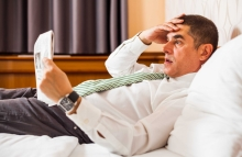 http://www.shutterstock.com/pic-266425424/stock-photo-businessman-lying-in-bed-and-reading-bad-news-in-newspaper.html