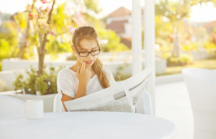 http://www.shutterstock.com/pic-152672726/stock-photo-woman-with-newspaper.html