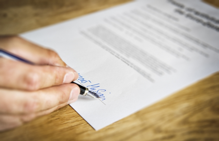 http://www.shutterstock.com/pic-294583739/stock-photo-image-of-a-hand-that-signs-a-business-contract.html