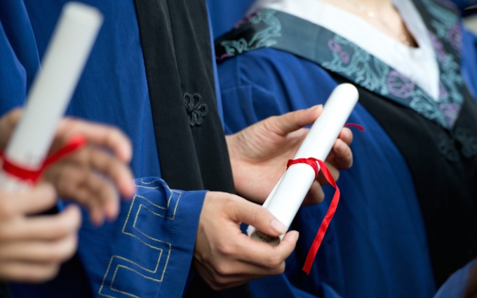 http://www.shutterstock.com/pic-116236396/stock-photo-people-in-a-gown-holding-a-diploma.html