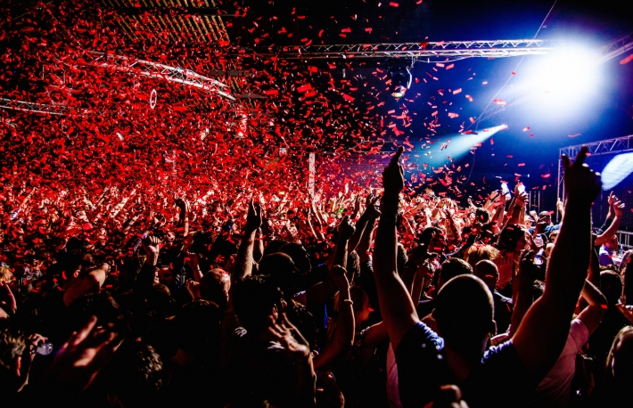 http://www.shutterstock.com/pic-199419065/stock-photo-nightclub-party-clubbers-with-hands-in-air-and-red-confetti.html?src=d_tWaOmIEmEtFPR5HaS-PQ-1-2