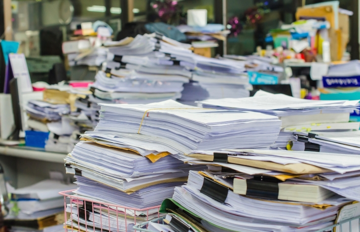 http://www.shutterstock.com/pic-241636831/stock-photo-pile-of-documents-on-desk-stack-up-high-waiting-to-be-managed.html?src=O-od5jiNKco6StX2Gim1tg-1-12