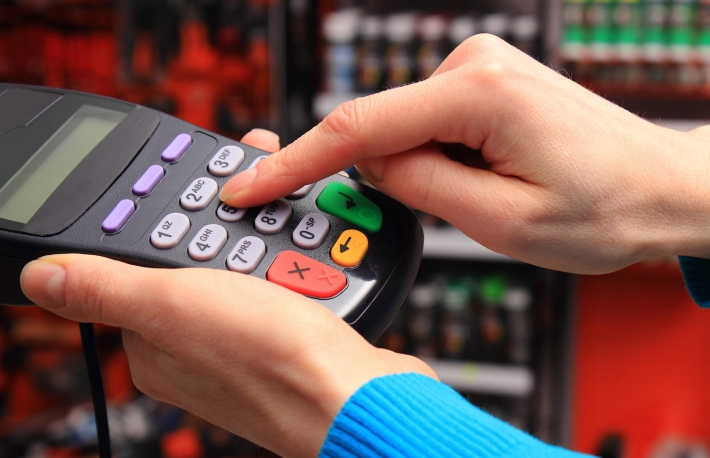 http://www.shutterstock.com/pic-262327565/stock-photo-hand-of-woman-using-payment-terminal-in-an-electrical-shop-enter-personal-identification-number.html?src=bsT-tiX8H36mF7HetIxq0g-1-45