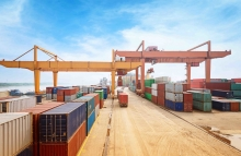 http://www.shutterstock.com/pic-198917756/stock-photo-stack-of-cargo-containers-at-the-docks.html
