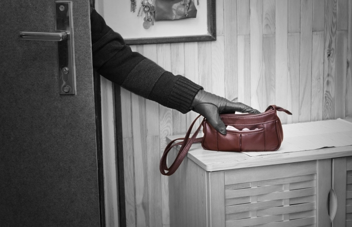 http://www.shutterstock.com/pic-95263264/stock-photo-thief-breaking-in-doors-and-stealing-a-handbag.html?src=s1SDbeLLsxvj2OKyOI3qLg-1-5