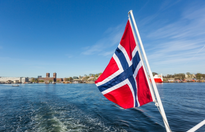 http://www.shutterstock.com/pic-324044258/stock-photo-norwegian-flag-waving-on-poop-of-a-boat-in-the-oslo-fjord-on-background-there-are-the-wake-of-the.html?src=6k30mxuWUv7Vgtqmf0ZqVg-1-7