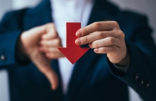 http://www.shutterstock.com/pic-238100128/stock-photo-business-person-holds-red-arrow-and-shows-thumb-down.html?src=xMUzh2zYz3ekyfGCP4TUMQ-1-28