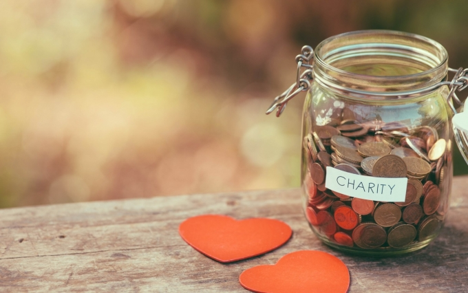 http://www.shutterstock.com/pic-228578737/stock-photo-money-jar-full-of-coins-for-charity-and-a-couple-of-heart-shapes.html