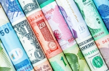http://www.shutterstock.com/pic-258312164/stock-photo-a-backgrounds-with-colorful-of-many-roll-currency-from-many-country.html