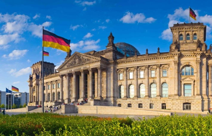http://www.shutterstock.com/pic-171405479/stock-photo-warm-evening-sunlight-illuminating-the-mighty-reichstag-parliament-with-clear-blue-sky-and.html