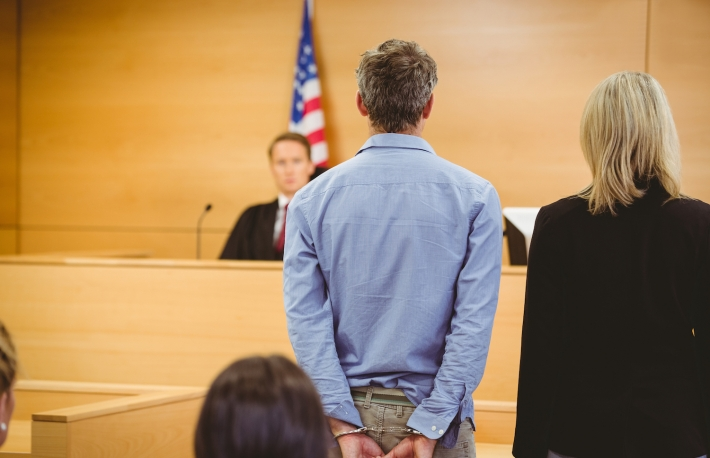 http://www.shutterstock.com/pic-243763714/stock-photo-criminal-waiting-for-courts-ruling-in-the-court-room.html?src=PvMWCSu4EFv8jTw5JnYefA-1-12