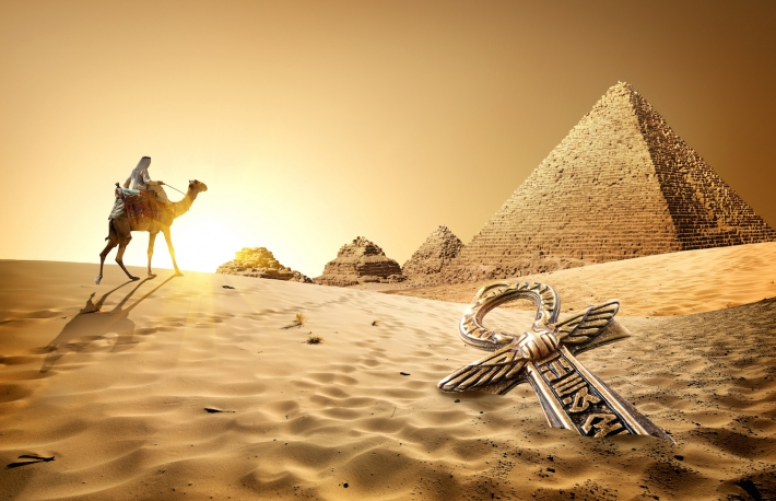 http://www.shutterstock.com/pic-328137680/stock-photo-bedouin-on-camel-near-pyramids-and-ankh-in-desert.html?src=JmviZBLgioFUR_D8J-TZ1A-1-12