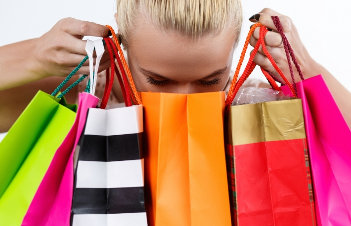 http://www.shutterstock.com/pic-298049027/stock-photo-blond-woman-inspecting-content-of-colored-paper-bags-with-fresh-buyings-shopping-consumerism.html?src=48ZQEy_axIY7NTN1KxRzZA-1-6