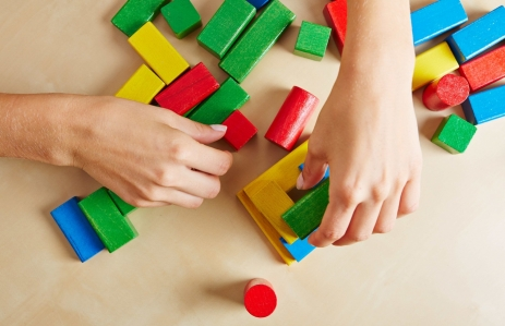 http://www.shutterstock.com/pic-153564275/stock-photo-two-female-hands-playing-with-colorful-wooden-building-blocks.html?src=zhtSIgNannvy4_D9Mn9SBA-1-82