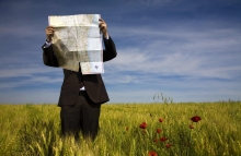 http://www.shutterstock.com/pic-23639869/stock-photo-businessman-lost-in-field-using-a-map.html