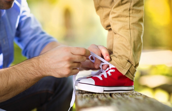 http://www.shutterstock.com/pic-223573555/stock-photo-father-is-helping-his-son-to-tie-his-shoes-in-summer-nature.html
