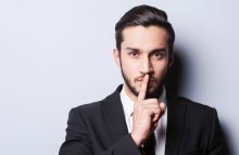 http://www.shutterstock.com/pic-234198232/stock-photo-keep-my-secret-serious-young-man-in-formalwear-holding-finger-on-lips-and-looking-at-camera-while.html?src=JOtDQxMaKwe3iyio7obBlw-1-10