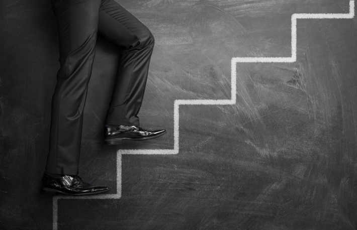 http://www.shutterstock.com/pic-131404658/stock-photo-businessman-climbing-the-career-stairs-drawn-on-a-chalkboard-with-copy-space.html