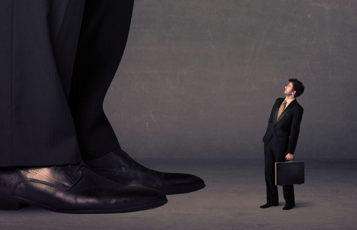 http://www.shutterstock.com/pic-291287525/stock-photo-huge-legs-with-small-businessman-standing-in-front-concept-on-background.html?src=x1Z320Jn9l_Rp-SnfY8qmg-1-88