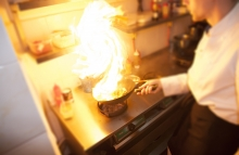 http://www.shutterstock.com/pic-116042332/stock-photo-chef-is-making-flambe-with-pan-and-fire.html