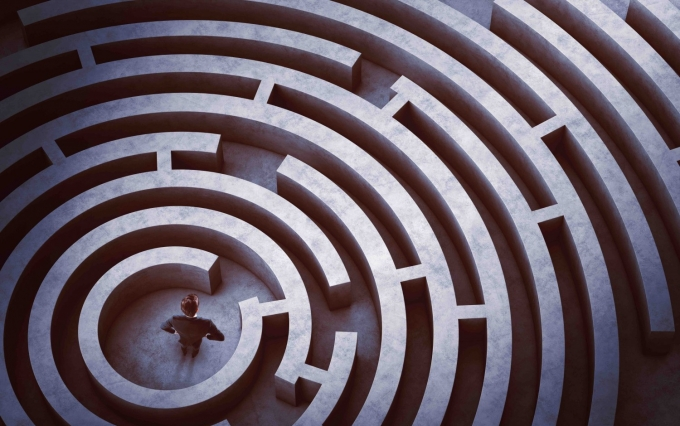 http://www.shutterstock.com/pic-333678827/stock-photo-businessman-at-the-center-of-a-maze.html