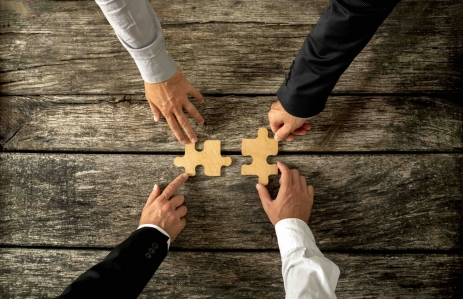 http://www.shutterstock.com/pic-307115906/stock-photo-four-successful-business-men-joining-two-puzzle-pieces-each-being-held-by-two-partners-rustic.html