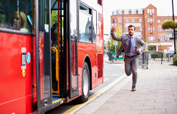 http://www.shutterstock.com/pic-217875652/stock-photo-businessman-running-to-catch-bus-stop.html