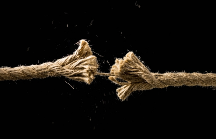 http://www.shutterstock.com/pic-200797052/stock-photo-concept-of-danger-and-risk-with-two-ends-of-a-frayed-worn-rope-held-together-by-the-last-strand-on.html
