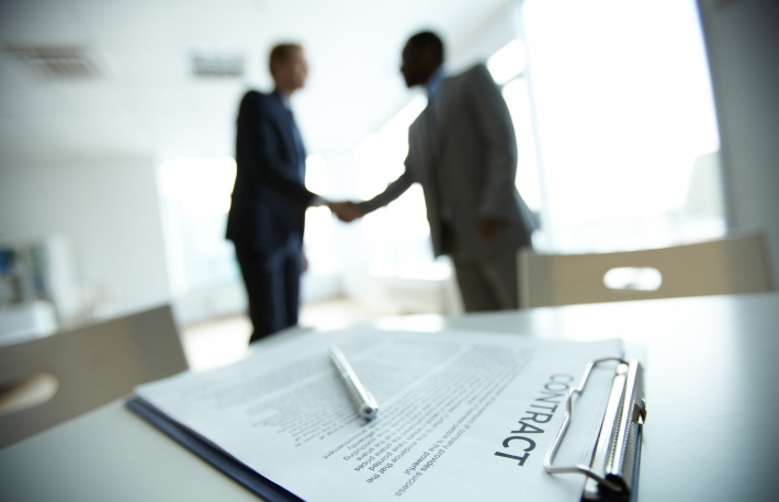 http://www.shutterstock.com/pic-120064627/stock-photo-image-of-business-contract-on-background-of-two-employees-handshaking.html?src=RIvNs4CDRzrj5GCdcO3uJg-1-15