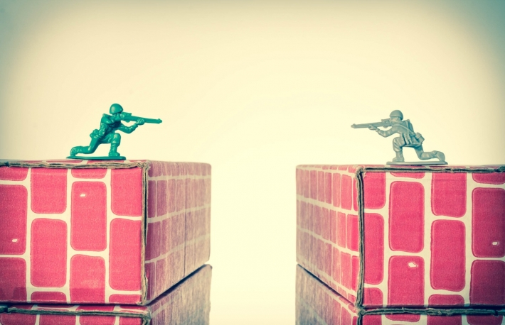 http://www.shutterstock.com/pic-347234978/stock-photo-rival-toy-army-men-aim-guns-at-eachother-atop-opposing-toy-bricks.html