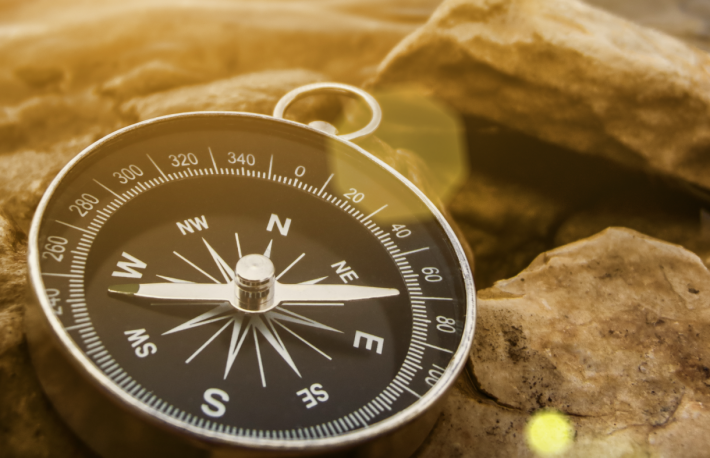 http://www.shutterstock.com/pic-171191216/stock-photo-compass-on-the-bank-with-sunflare.html