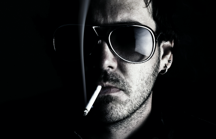 http://www.shutterstock.com/pic-63408100/stock-photo-low-key-portrait-of-a-man-wearing-sunglasses-and-smoking-a-cigerette.html