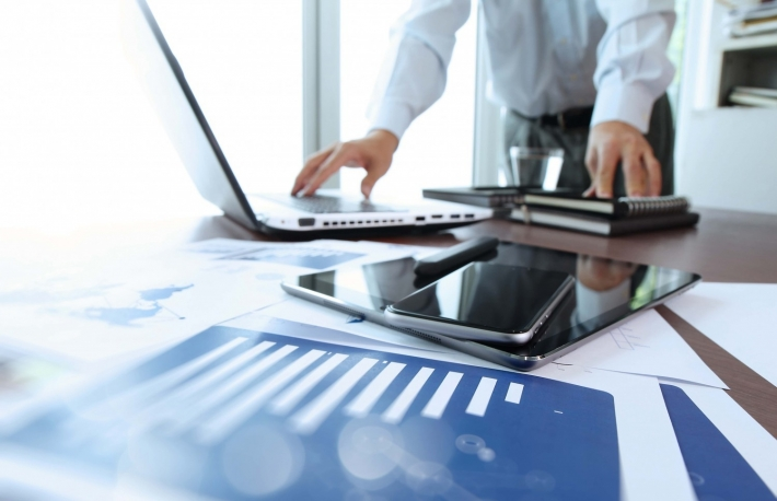 http://www.shutterstock.com/pic-273387659/stock-photo-business-documents-on-office-table-with-smart-phone-and-digital-tablet-and-man-working-in-the.html