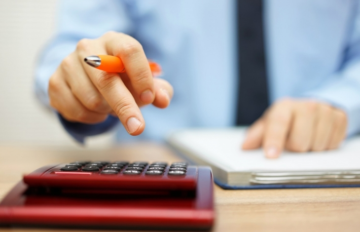http://www.shutterstock.com/pic-328394324/stock-photo-shallow-depth-of-field-of-accountant-calculating-financial-data.html