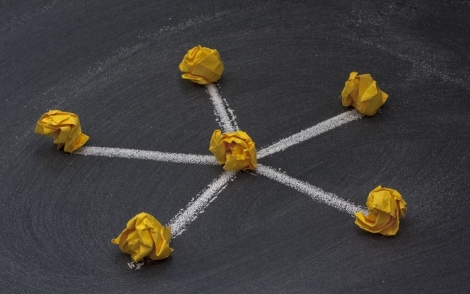 http://www.shutterstock.com/pic-27934021/stock-photo-model-of-star-hub-and-spokes-network-with-a-central-node-made-with-yellow-crumbled-paper-nodes.html