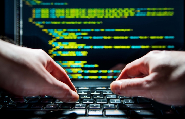 http://www.shutterstock.com/pic-380107105/stock-photo-hacker-using-laptop-lots-of-digits-on-the-computer-screen.html