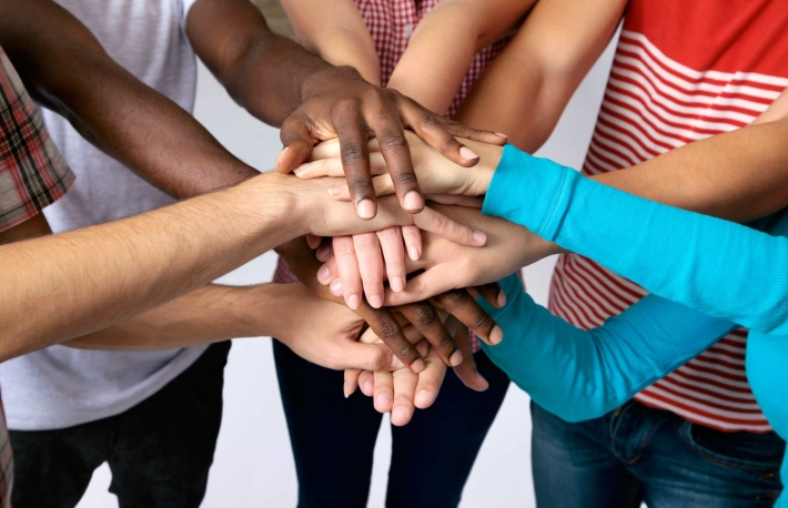 http://www.shutterstock.com/pic-113484922/stock-photo-team-of-friends-showing-unity-with-their-hands-together.html?src=em3tofpRa5GFxe-orRr4_Q-1-76
