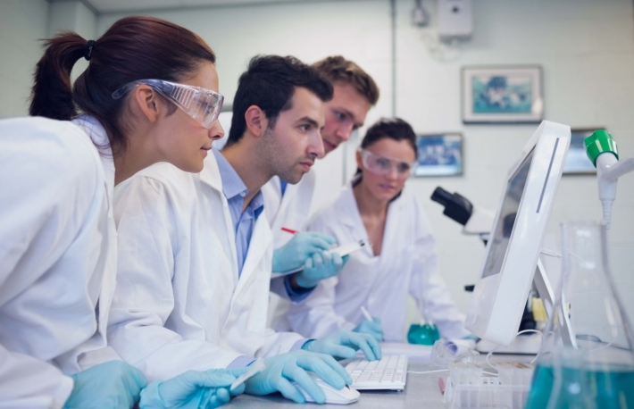 http://www.shutterstock.com/pic-160671770/stock-photo-side-view-of-serious-researchers-looking-at-computer-screen-in-the-laboratory.html