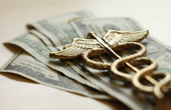 http://www.shutterstock.com/pic-180406142/stock-photo-expensive-healthcare-concept-caduceus-on-us-money.html
